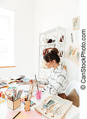 Concentrated woman fashion illustrator drawing - Image of...