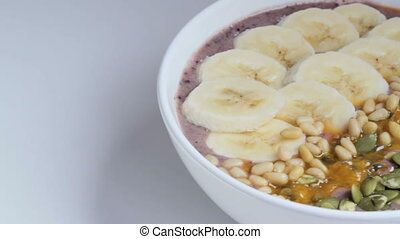 Smoothie bowl against white background - Close up of big...