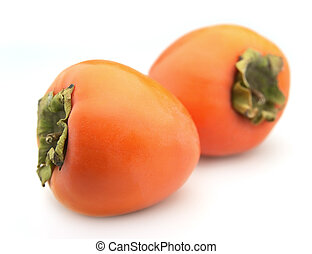 Ripe persimmon closeup on a white background
