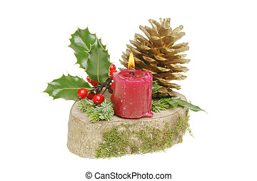 Yule log with holly, ivy, pine needles, golden pine cone and...