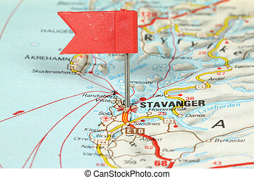 Stavanger - famous city in Norway. Red flag pin on an old...