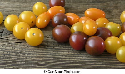 Cherry tomatoes on rustic wooden background