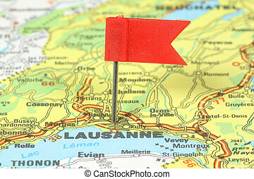 Lausanne - famous city in Switzerland. Red flag pin on an...