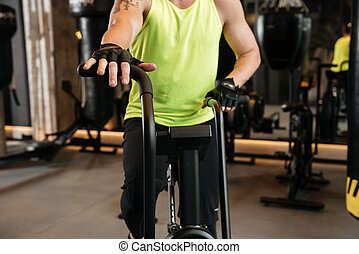Cropped image of a sportsman on a treadmill at the gym