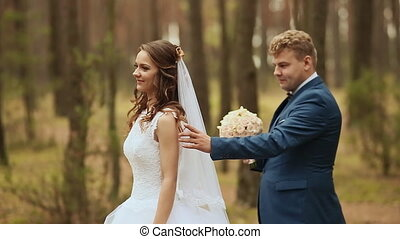 Wedding. Happy couple in a forest in the fresh air. Elegant...