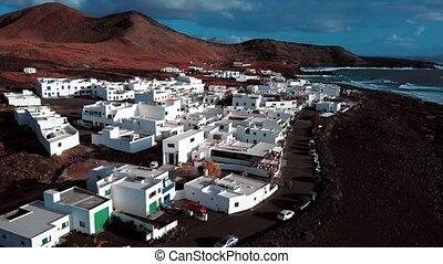 Flying over El Golfo village, Lanzarote, Canary Islands,...