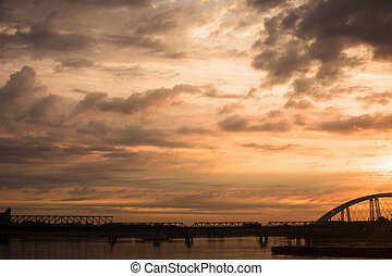 dramatic sky at sunset - Bridge on Danube in Novi Sad in...