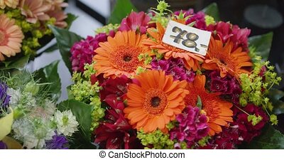 Bouquets with prices - Close-up shot of colorful fresh...