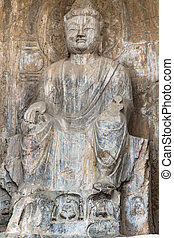 carved figure in Longmen Grottoes - LUOYANG, CHINA - MARCH...