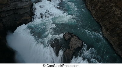 Aerial shot from copter to beautiful powerful Gullfoss waterfall. Scenic landscape of water and cliffs in Iceland.