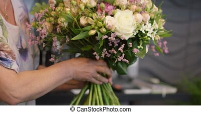 Corp person holding bouquet - Close-up shot of anonymous...