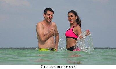 Woman Having Fun Splashing In The Water