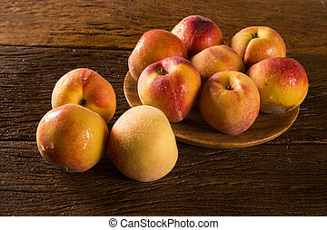 Nectarines on wooden table.