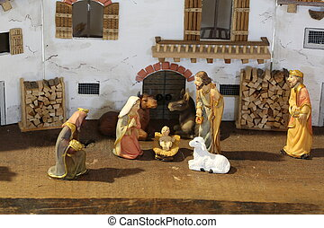 Traditional reconstruction of a nativity scene with the holy...