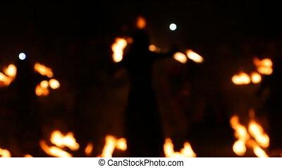 Blurred View, Fire Show. Men make fire circles. Blurry...