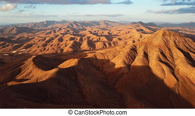 Flight over desert landscape, Fuerteventura island, Spain -...