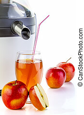 Electric juicer and apple juice in glass