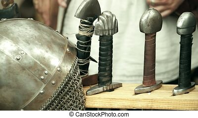 Handles of swords and chain armour