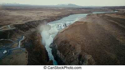 Aerial view of the scenic landscape in Iceland. Waterfall...