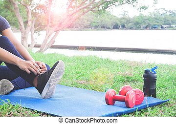 Fitness woman getting ready for workout in the park