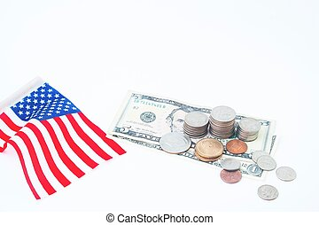 Stack of coins and dollars bill with usa flag on white,...