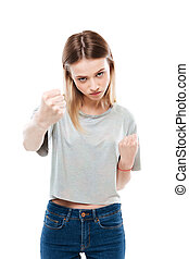 Portrait of a serious aggresive woman showing two fists...
