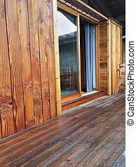 wooden terrace and cladding - cladding and wooden deck of a...