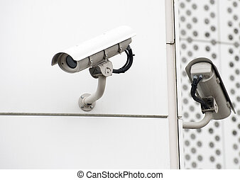 Close-up view of surveillance cameras on the street.