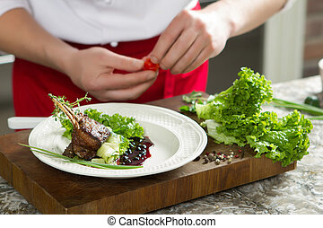 Lamb ribs with vegetables and seasoning on wooden background