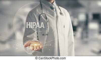 Doctor holding in hand HIPAA - Concept of application new...