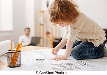 Serious boy drawing picture on the paper - Just do it....