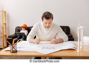 Very attentive engineer figuring on result - Work for...