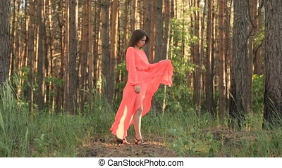 Girl in evening dress in red color in the forest - Girl in...
