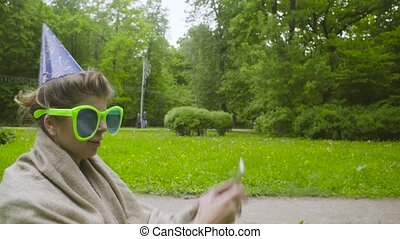 Young woman in funny glasses taking pictures