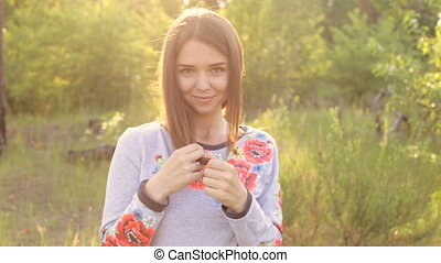 Girl in Ukrainian embroidered outdoor - A girl in Ukrainian...