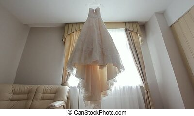 Wedding Dress in Room. - White wedding dress of the bride in...