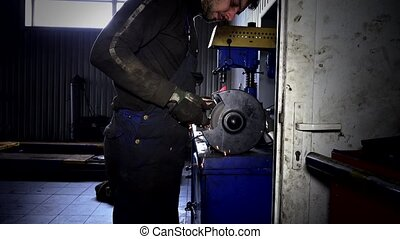 Sparks coming out from grinding wheel. Mechanic polish brake...