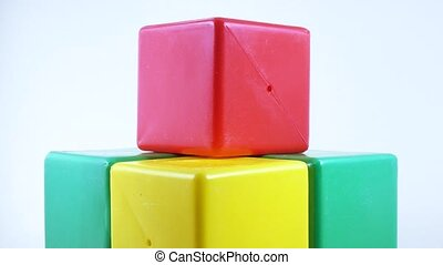 Plastic toy cube rotation - Rotation of a green plastic toy...