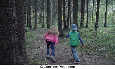 Children running in forest