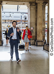 Business People Commuting To Work - Businesspeople are...