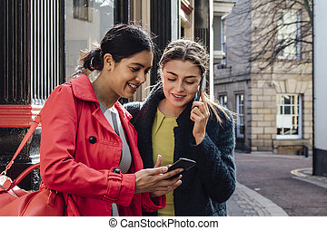 Businesswomen Going To Work - Two businesswomen are...