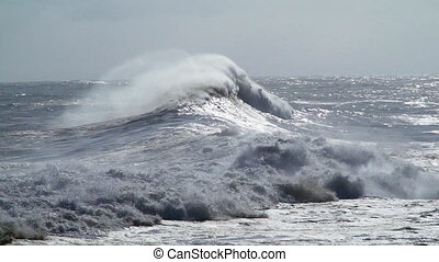 big stormy waves in the ocean - huge waves break on the...