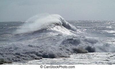 big stormy waves in the ocean - huge waves break on the...