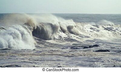 storm waves crash onto the shore - waves in slow motion