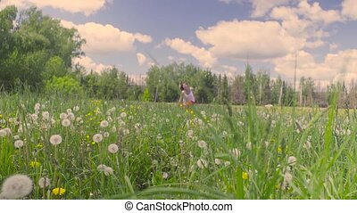 Young woman running on the meadow