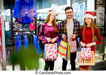 Friends shopping in mall - A group of friends is shopping...