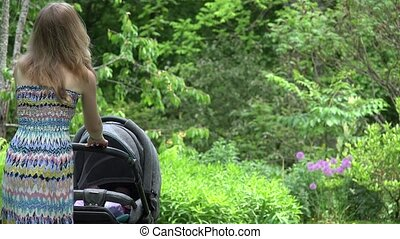 Woman in dress try to send baby child to sleep in stroller...