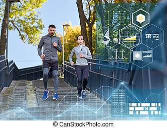 couple running downstairs in city - fitness, sport and...