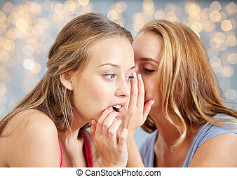 happy young women whispering gossip - friendship, people and...