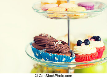 close up of cake stand with cupcakes and cookies - unhealthy...